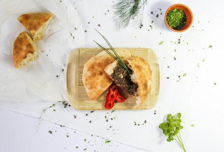 Venison goulash in traditional bread